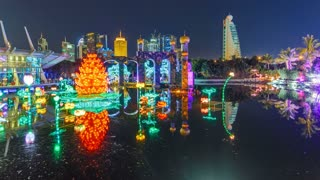 Lake with flowers and castle. Newly opened Dubai Glow Garden timelapse is a state of Art architecture featuring environment friendly architecture, creating various structures from the recyclable