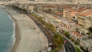 Landscape mediterranean town. Azure sea with beautiful beach with palm trees. Time lapse
