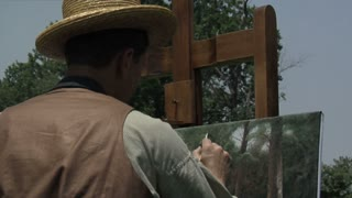 landscape painter working outdoors, tight over the shoulder shot