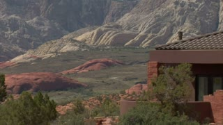 Large Desert Home With The Red Rock Desert In Distance