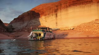 Large Houseboat Docked In Red Rock Canyon Lake Powell Utah