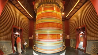 Large Prayer Wheel at New Buddha Tooth Relic Temple and Museum on South Bridge road in Singapore, South East Asia, Time lapse