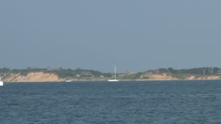 Large Sailboat Drifting Across Bay