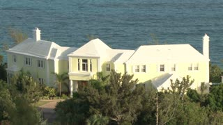 Large Yellow Mansion in Bermuda With Ocean in Backyard