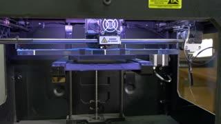 Laser cutting machine at work, dolly shot