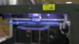 Laser cutting machine at work, dolly shot