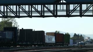 Last Half Of Train Passes Under A Bridge