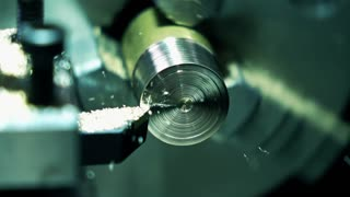 Lathe machine in action, super slow motion. Machining brass piece 250 fps macro shot