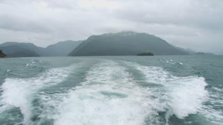 Leaving Mountains Behind Boat Wake