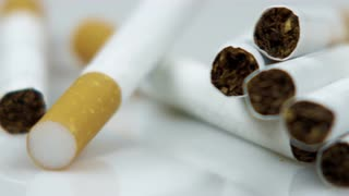 Left to Right Pan of Group of Cigarettes 2