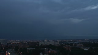 Lighning over DC skyline with plane