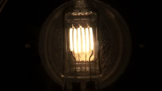 Light Bulb with Several Filaments Fades On and Off