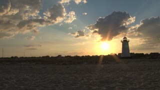 Lighthouse and Beautiful Beach Sunset