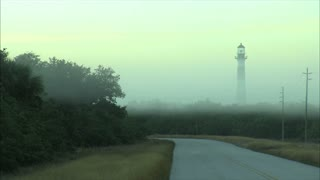 Lighthouse Surrounded By Dense Fog