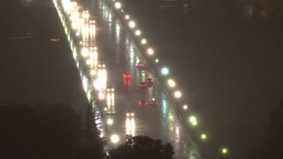 Lightning Flashes Over Bridge With Traffic