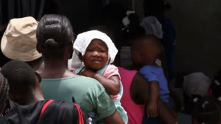 Lines Of People At Vaccination Clinic In Haiti