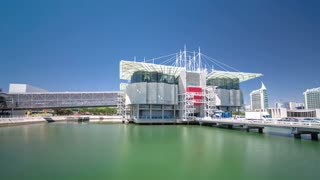 Lisbon Oceanarium, the second largest oceanarium in the world and the biggest in Europe. Parque das Nacoes. Portugal. Timelapse hyperlapse with blue sky and green water 4K