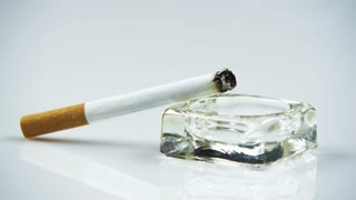 Lit Cigarette in Ashtray 7