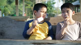 Little asian child enjoy eating ice cream together