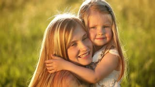 Little blonde girl hugging her mother