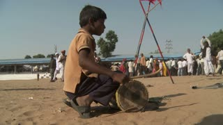 Little Boy Drumming For Rope Trick in India