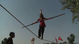 Little Girl Doing Rope Trick in India