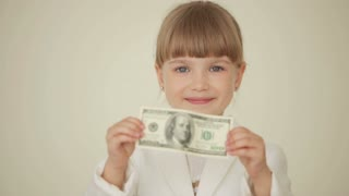 Little girl holding banknote