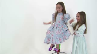 Little Girl Kicking Off Shoes and Spun Around in Tall Chair