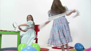 Little Girl Spins as Her Twin Plays with Makeup