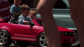 Little Kids In Toy Mustang
