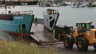 Loader Forklift Loading Container on Landing Craft