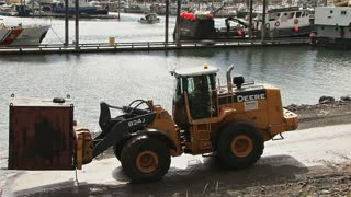 Loader Forklift Moving Waste Container Onto Boat