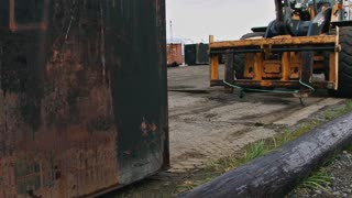 Loader Forklift Picking Up Waste Oil Container