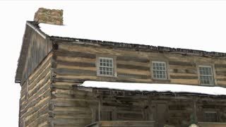 Log House In The Snow