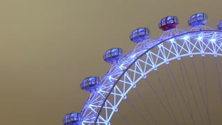 London Eye at Night Tilt Down Zoom Out