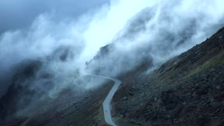 lonely road. foggy mountains. time lapse. beautiful landscape.