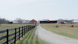 Long Shot of Fence and Farm