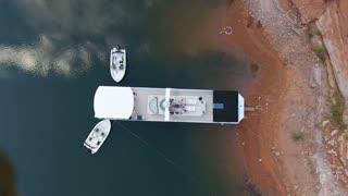 Looking straight down at a houseboat in peaceful water in Lake Powell