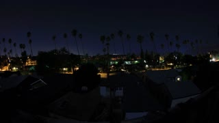 Los Angeles Night Time-Lapse. Los Angeles, Pasadena area with palm trees and freeway traffic shot in timelapse at night.