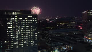 Lots of Fireworks Behind Building in DC
