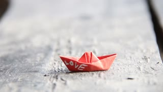 love or wedding idea, text on a paper boat