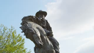 Low Angle Shot of Cowboy on Horseback in Pioneer Plaza Dallas