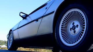 Low Angle Shot of Delorean Tires and Drivng Out of Frame