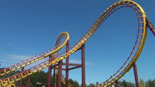 Low Angle Shot of Huge Roller Coaster Turn