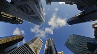 Low angle view of Banks and Commercial buildings in Singapore's CBD, Central Business District, Singapore, South East Asia, Time lapse