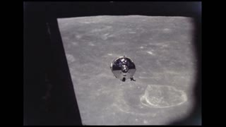 Lunar Module Descending to Moon Crater