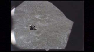 Lunar Module Floating to Moon Surface
