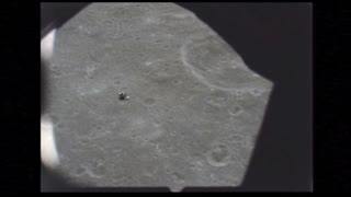 Lunar Module In Distance Heading To Surface