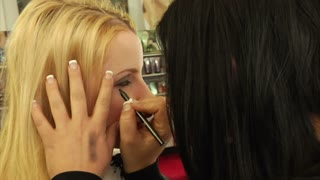 Makeup Artist Applies Eye Makeup To Client