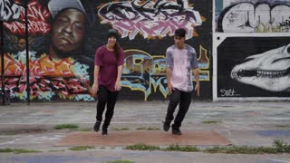 Male and Female Break Dancers in Urban Setting